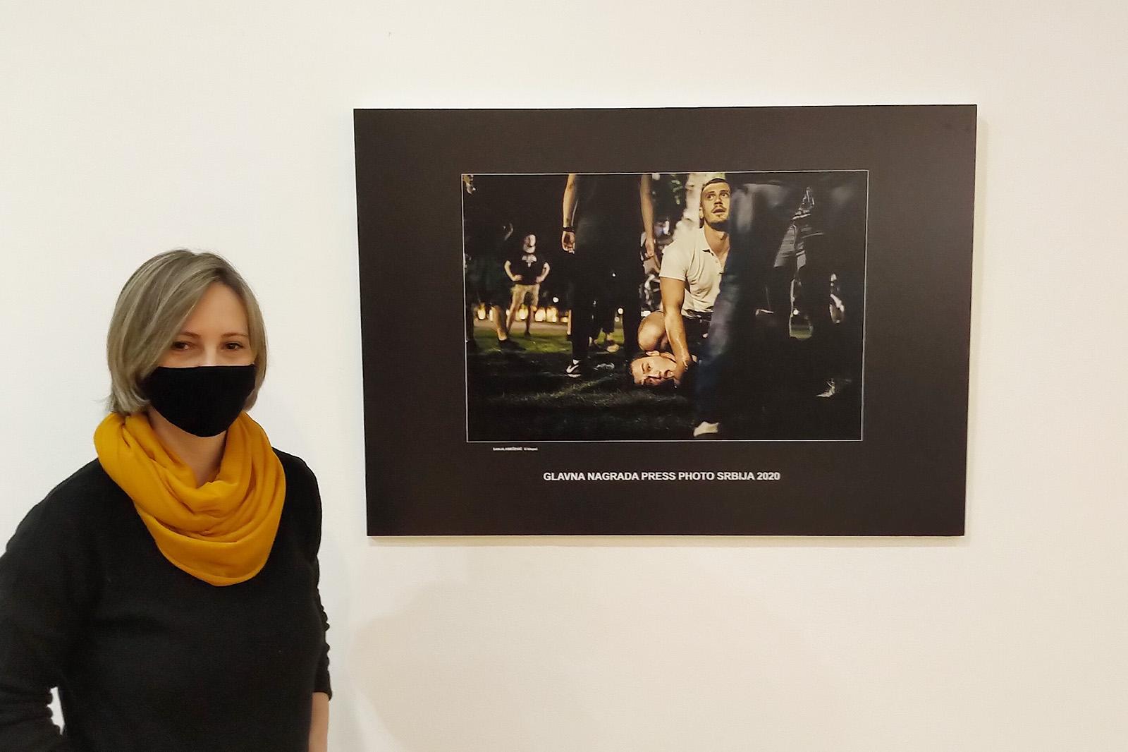 Sanja Knezevic photographer standing next to her winning photo ''Captured''